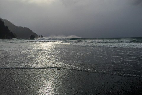 View of the waves and beach from Johnstone Bay