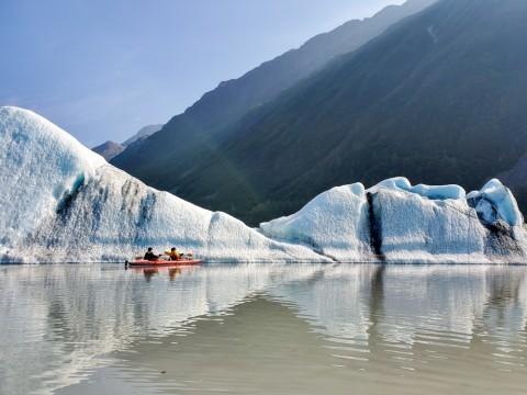 A kayaker paddles in Valdez Glacier Lake