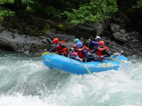 A group splashes down Six Mile Creek with NOVA Alaska Guides
