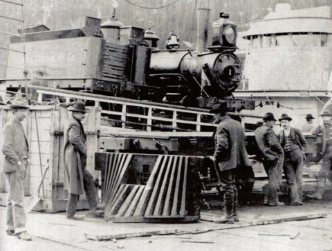 Old photo of a few men standing by an Alaska Railroad train