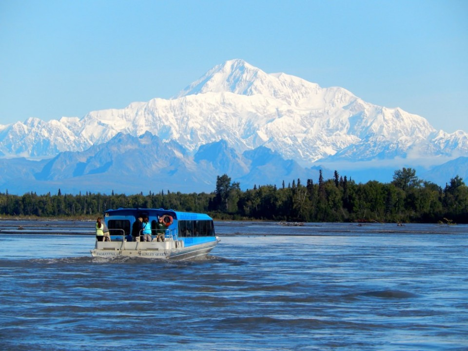 A jetboat on the water with Mt. Denali in the background.
