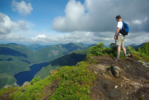 A hiker soaks in the scenery atop Deer Mountain.