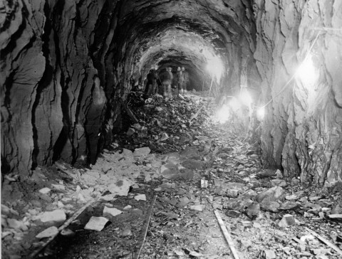 An old black and white view of the Anton Anderson Memorial Tunnel during it's construction.