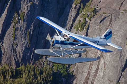 Fly over gorgeous fjords, narrow inlets and steep-sided cliffs