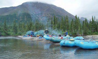 Aniak-air-guides-Rafting-Many_Rafts_on_River-pmesu9