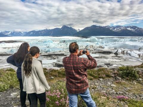Family takes photo of a glacier