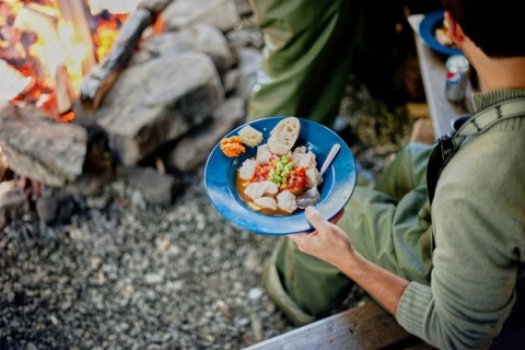 Your catch becomes the fresh center of a gourmet campsite meal.