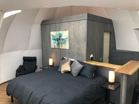 Each igloo has cozy furnishings, a private bath, and breakfast bar.