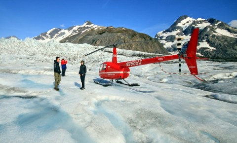 A sleek and powerful helicopter lifts you and your travel companions where no car, boat or train can
