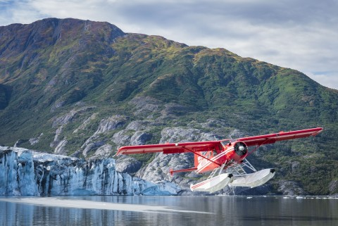 Floatplane landing in front of glacier in Prince William Sound