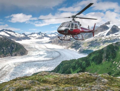Helicopter flies over glacier in Juneau