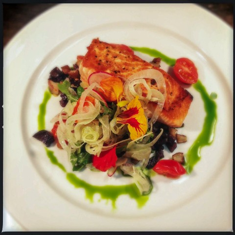 An elegantly arranged dish of fish.