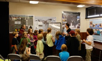 Sitka whalefest alaska The Science Exhibit Room at Whale Fest where a scientist is giving a talk to grade school children Tim Shobe whale fest