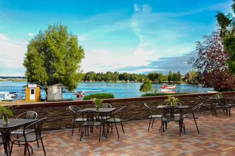 The outside dinning area of the Lakefront Anchorage with views of float planes on Lake Hood.
