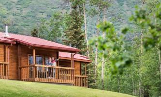 Property Man and woman on cabin deck at Kenai kpl 19 alaska kenai princess wilderness lodge