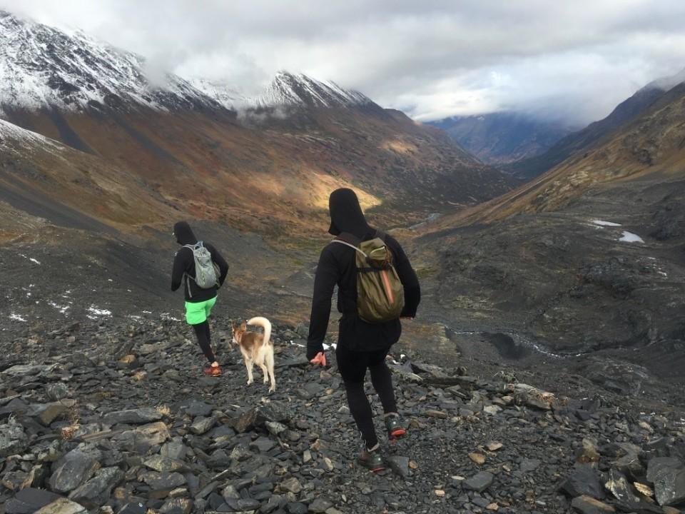 Hikers descend Crow Pass towards Eagle River