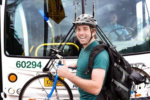 Man loading bike on bus