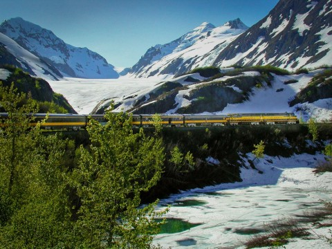 Travel through steep mountain passes, with views of glaciers just out your window