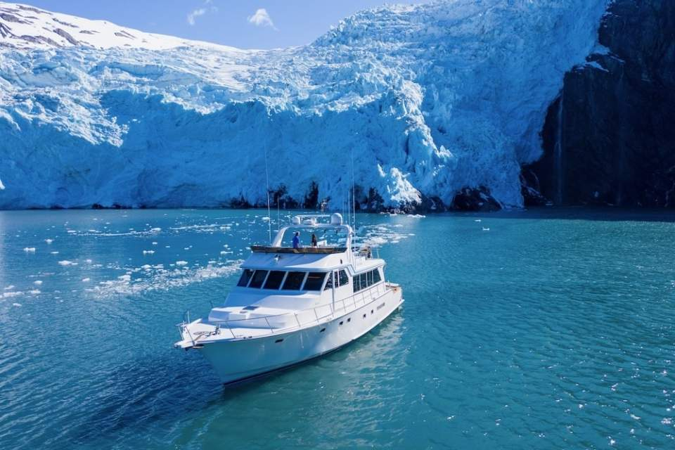 Alaskan Luxury Cruises pauses in front of a glacier in Prince William Sound