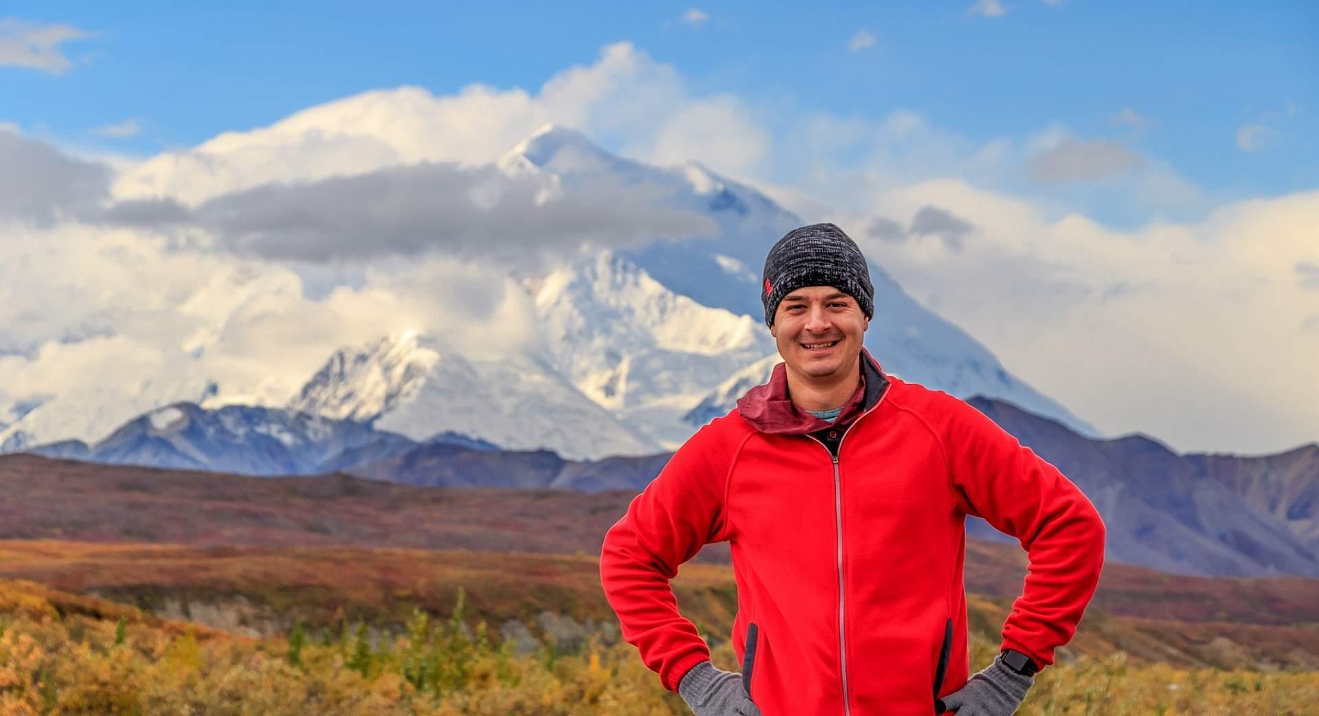 Alexyn Scheller stands in from of Denali in Denali National Park