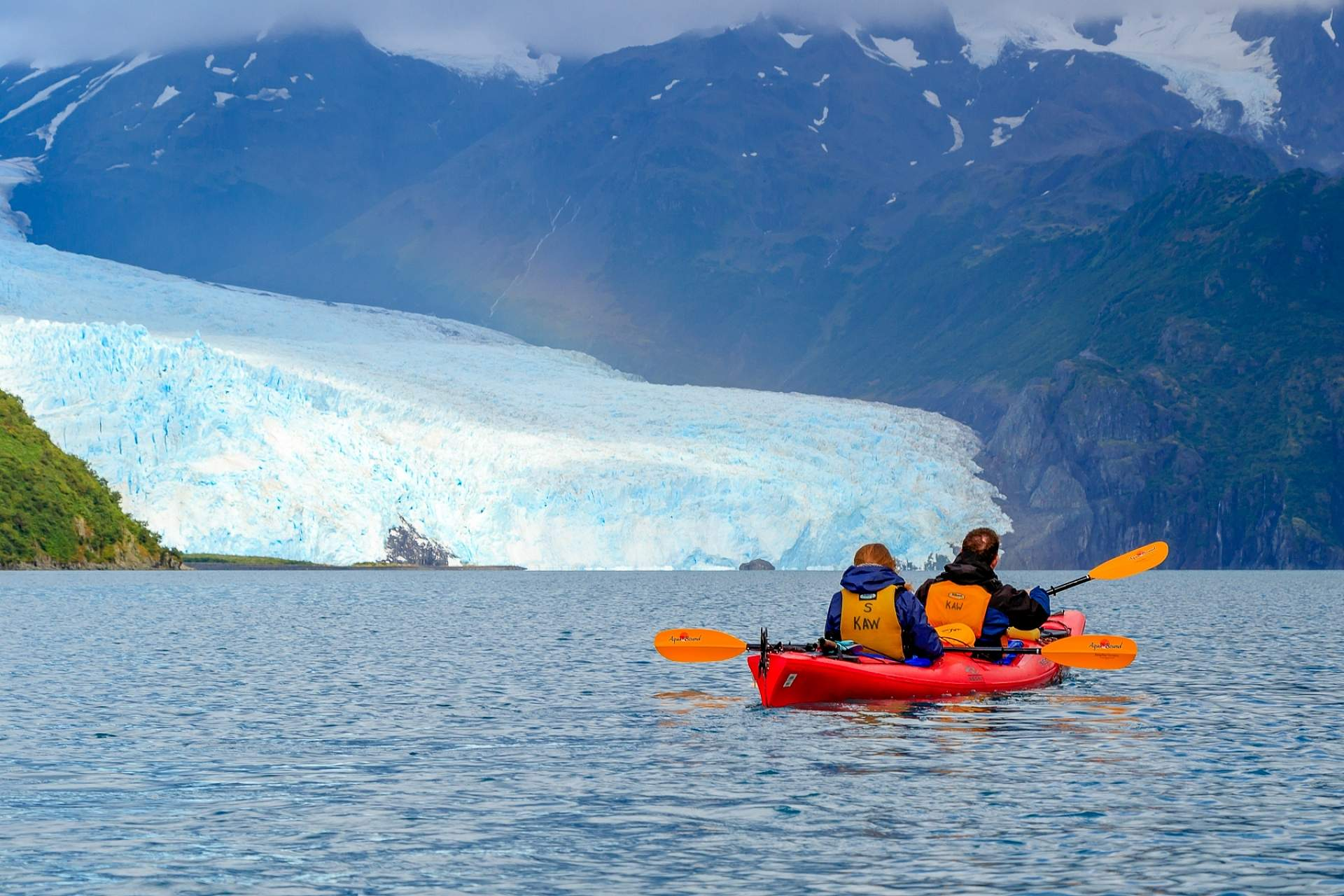 Kayak in front of Aialik Glacier in Kenai Fjords National Park