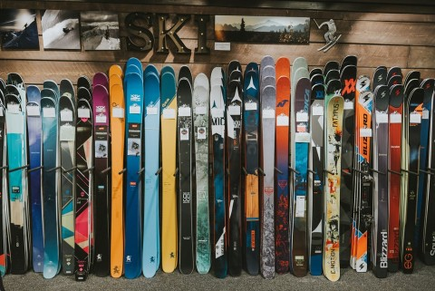 Skis stacked in a row at The Powder Hound Ski Shop