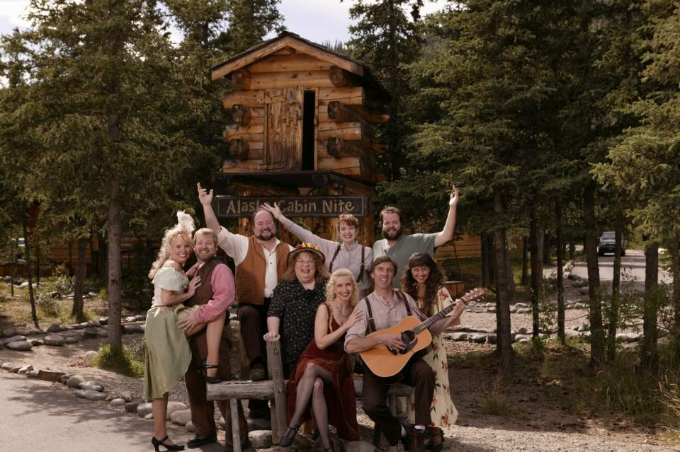 The cast of Cabin Nite Dinner Theater pose in costume