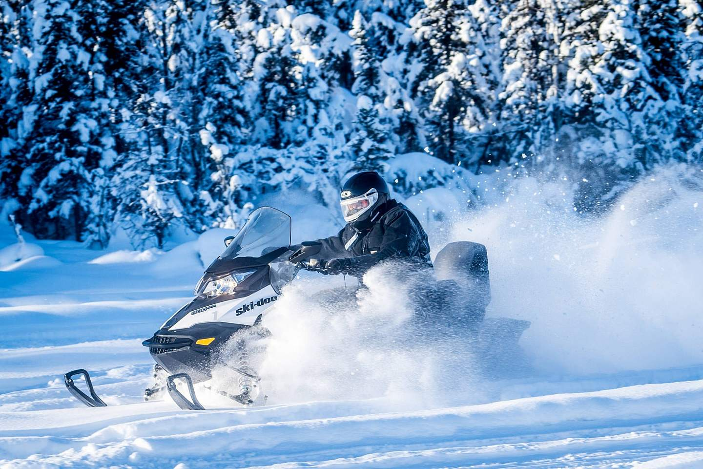 Someone on a snowmachining through the snow