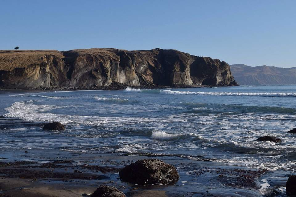 A cliff's edge and beach in Kodiak