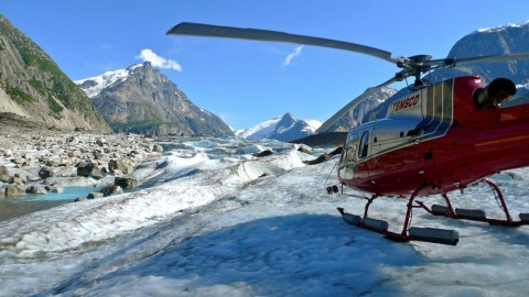 A helicopter landed on a glacier