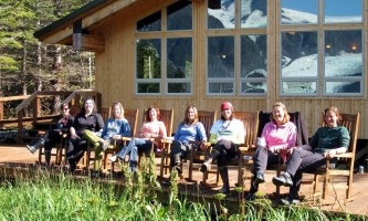 Alaska-Coast-To-Denali-Journey-27-Relaxing_on_the_Deck_at_Kenai_Fjords_Glacier_Lodge-pdvthq