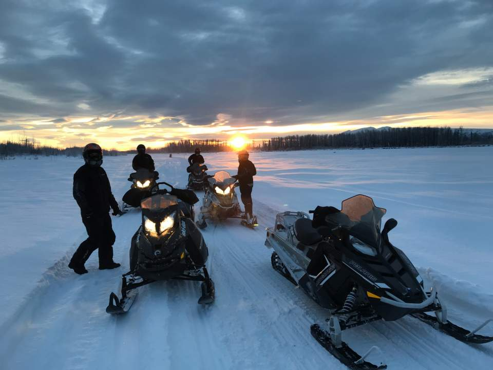 Traverse Alaska's backcountry by snowmachine, and stay at remote wilderness lodges