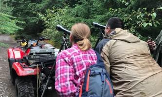 Girdwood Couple scoping for bears before puddle alaska atv adventures