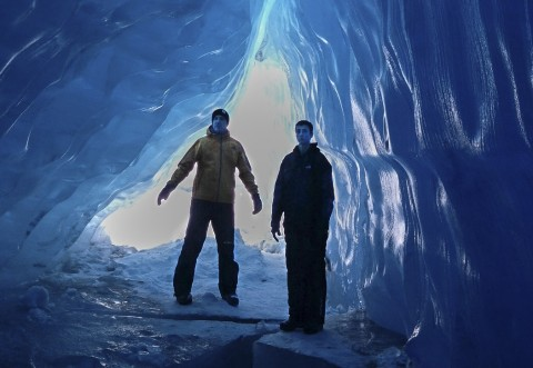 If conditions permit, discover the ice caves of Spencer Glacier
