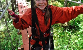 Alaska alpine zipline adventures juneau Alpine Zip JNU Girl crossing Bridge juneau