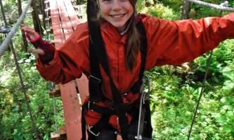 Alaska alpine zipline adventures juneau Alpine Zip JNU Girl crossing Bridge juneau