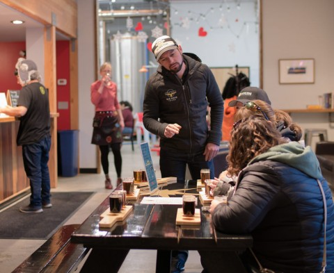 Big Swig owner Bryan with guests at an Anchorage brewery