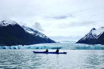 Glacier blue kayak Kayak with Spencer Glacier Face Background2019