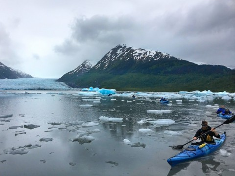 Paddler's take a 3-mile roundtrip exploration of Spencer Lake, navigating the icebergs that have calved from the glacier.