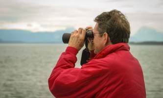 Glacier bay lodge GB tour man binolulars3 Alaska Channel