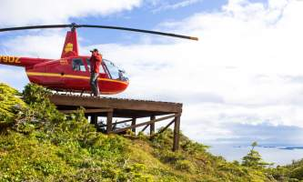 Helicopter Air Alaska Heli person on mtn top 8x11 52019