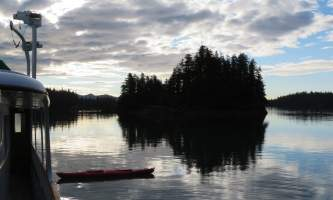 Alaska whittier North Pacific Expeditions Tonsina Bay Sunset off port side with kayak horizontal north pacific expeditions