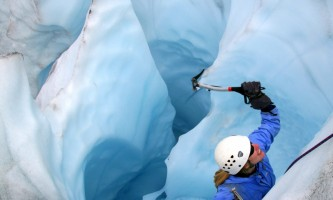 St elias alpine guides Ice Climbing out of a Moulin