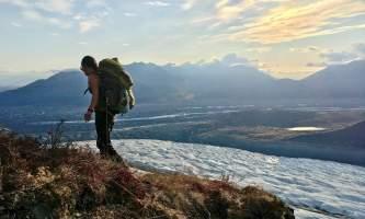 St elias alpine guides Hiker by Root Glacier Alaska