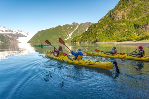 Kayakers paddle near Holgate Glacier in Kenai Fjords National Park