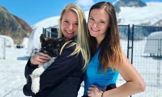 Alaska temsco mendenhall dog sledding Guests with Puppy TEMSCO Mendenhall Dog Sledding