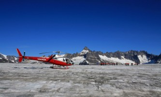 Temsco helicopter flightseeing Heli on Glacier Blue Sky Background