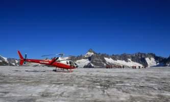 Temsco helicopter flightseeing Heli on Glacier Blue Sky Background