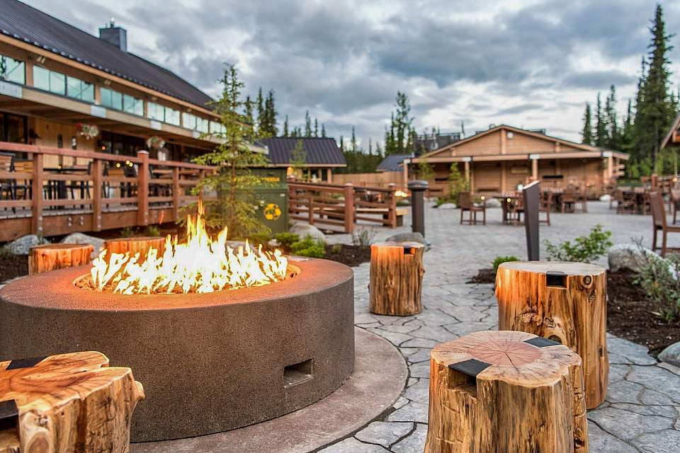 An outdoor fire pit in a rustic courtyard.