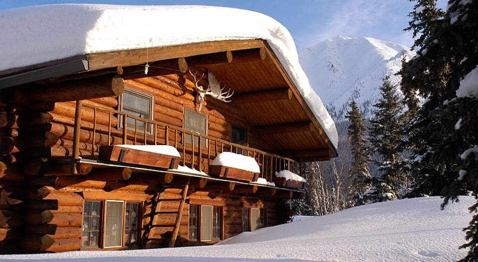 The lodge's huge picture windows make it easy to keep a lookout for the auroras from a warm, comfortable interior.